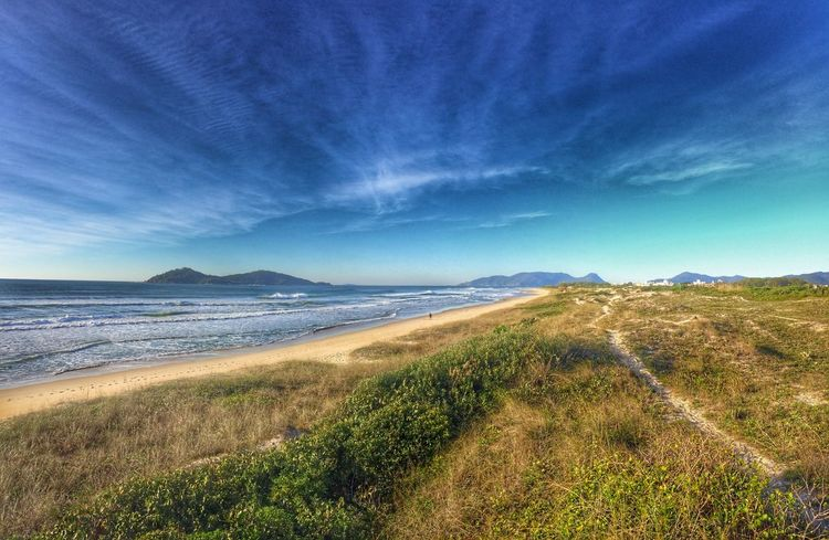 Beach Beauty In Nature Blue Cloud - Sky Coastline Day Distant Grass Green Color Majestic Mountain Nature Non-urban Scene Outdoors Remote Sand Scenics Sea Shore Sky Tranquil Scene Tranquility Water Wave First Eyeem Photo