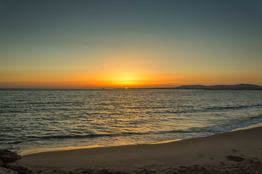 Sunset_collection Beach Beauty In Nature Clear Sky Costadecaparica Day Horizon Over Water Idyllic Nature No People Outdoors Sand Scenics Sea Shore Sky Sun Sunset Tranquil Scene Tranquility Travel Destinations Vacations Water Wave