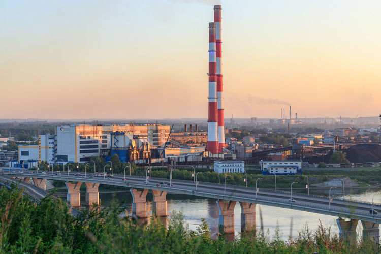 Industrial part of Kemerovo city. Industry Power Plant Air Pollution Architecture Bridge - Man Made Structure Building Exterior Built Structure City Connection Factory Fuel And Power Generation Industry No People Orange Color Outdoors Plant River Siberia Sky Smoke Stack Sunset Transportation Water