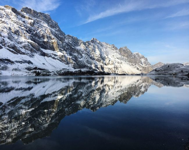 Mountain lake Reflection Water Lake Tranquil Scene Tranquility Mountain Beauty In Nature Nature Scenics Sky Waterfront Idyllic Mountain Range Outdoors Day No People Cloud - Sky Iceberg Shades Of Winter