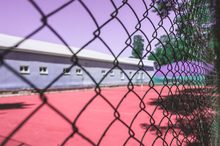 Close-up of soccer field seen through chainlink fence