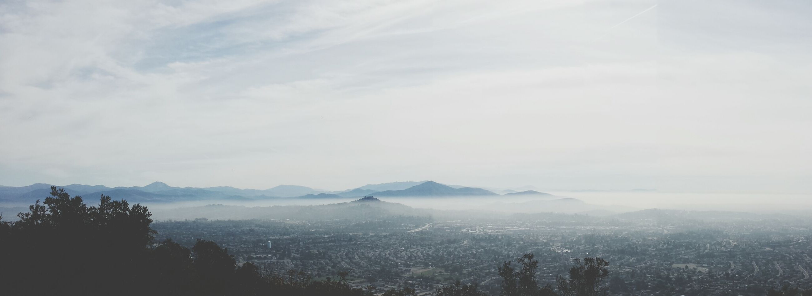 mountain, scenics, tranquil scene, beauty in nature, tranquility, landscape, sky, mountain range, nature, tree, fog, idyllic, cloud - sky, day, non-urban scene, outdoors, no people, high angle view, weather, aerial view