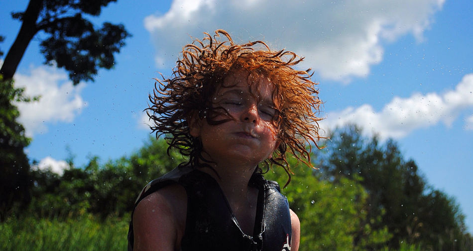 Close-Up Of A Boy Shaking Hair