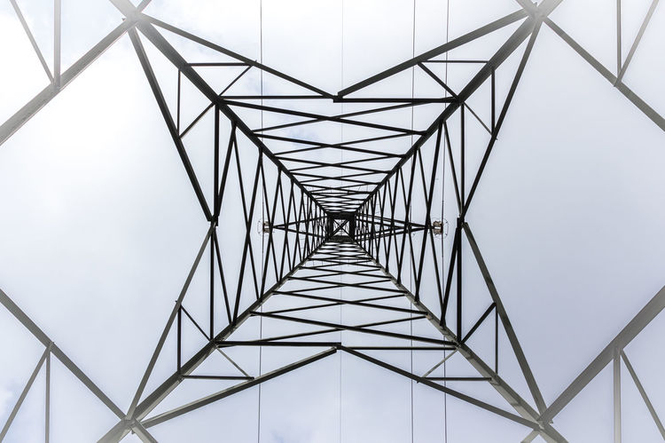 High voltage pylon into the fog. Bottom view. Pattern of metal architecture. Architecture Cloud Distribution Electric Grid High Industrial Industry LINE Lines Power Pylon Background Bottom Cable Danger Electrical Electricity  Energy Fog Foggy Generation Metal Mist Pattern