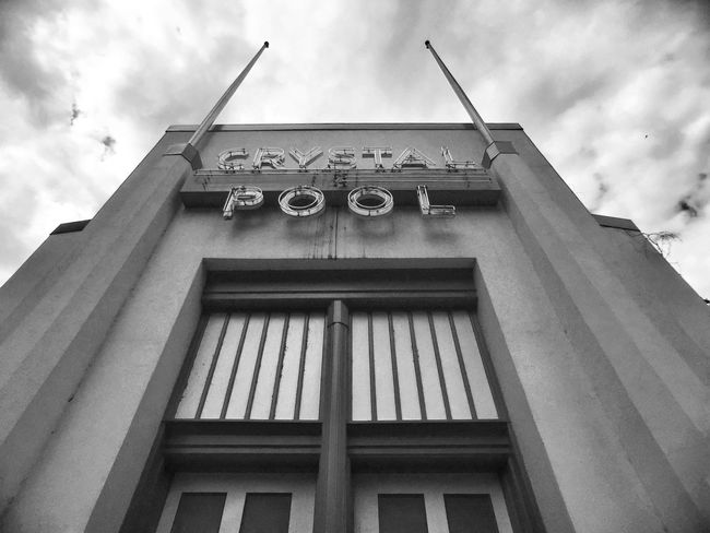 Low Angle View Cloud - Sky Architecture Built Structure Sky Text Western Script Cloudy Building Exterior Cloud Outdoors Day Façade No People Architectural Feature Glen Echo Park IPhoneography Black & White Monochrome Sign Man Made Object Crystal Pool