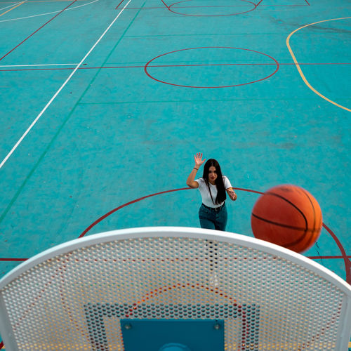 Woman dunking ball in basket