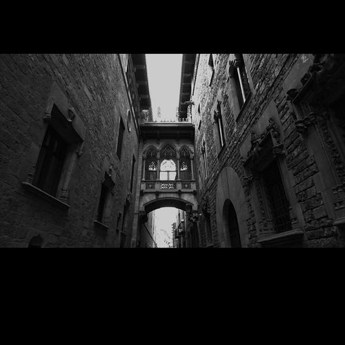 Carrer De Bisbe Low Angle View History Built Structure Arch Catalunyagrafias Luz E Sombra Cataluña Cataluñaexperience Catalunya Barcelona Catalunya Lliure Blancoynegrofoto Blanco Y Negro Somosfelices Tu Barcelona Catalunya_color Eyeemphotography Dia Caminar Illuminated Black Background Tranquility Fortheloveofblackandwhite Blancoynegro Black And White Photography No People