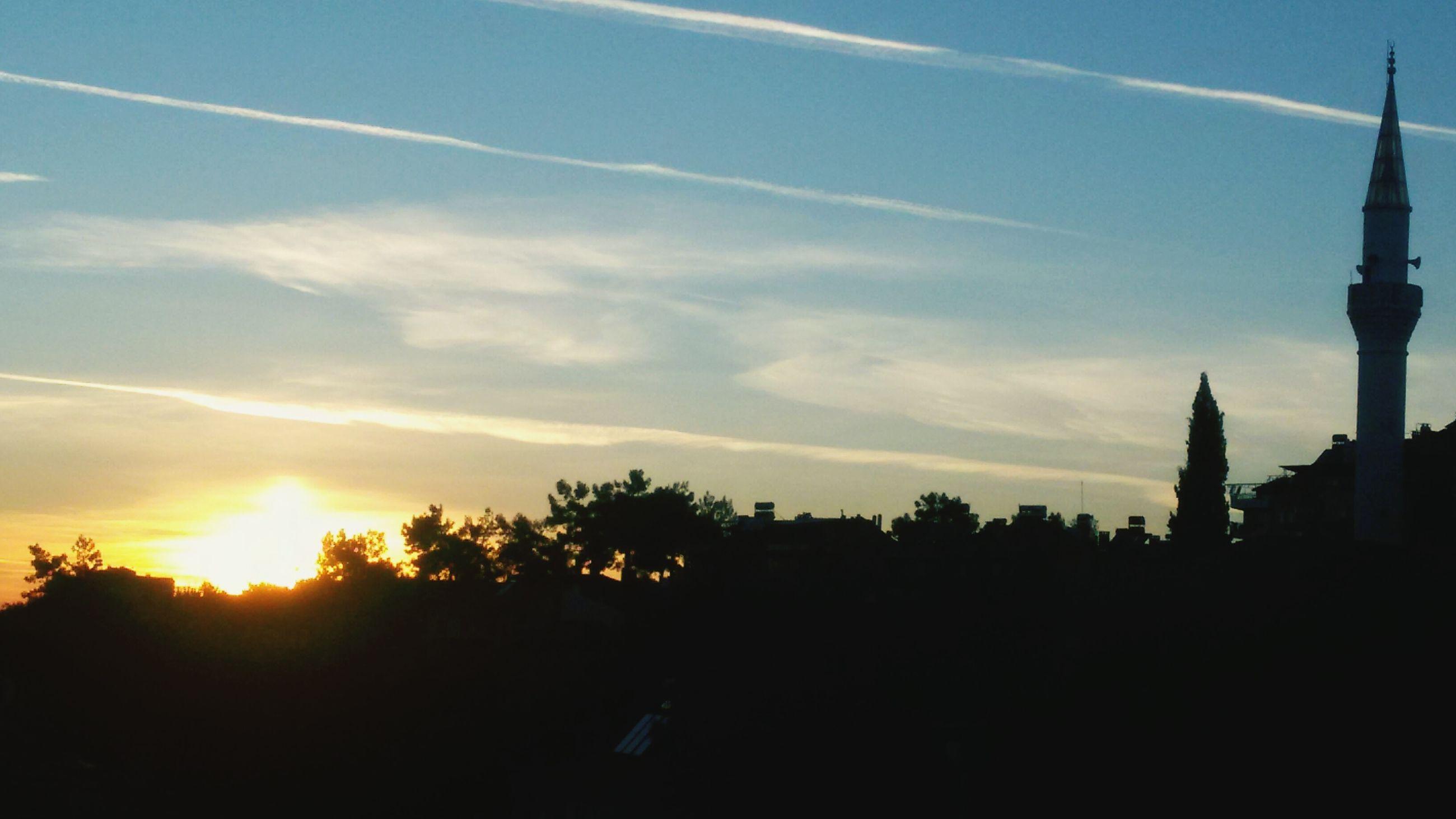 sunset, silhouette, tree, sky, scenics, tranquility, beauty in nature, built structure, architecture, tranquil scene, cloud - sky, building exterior, nature, sun, sunlight, cloud, idyllic, orange color, landscape, no people