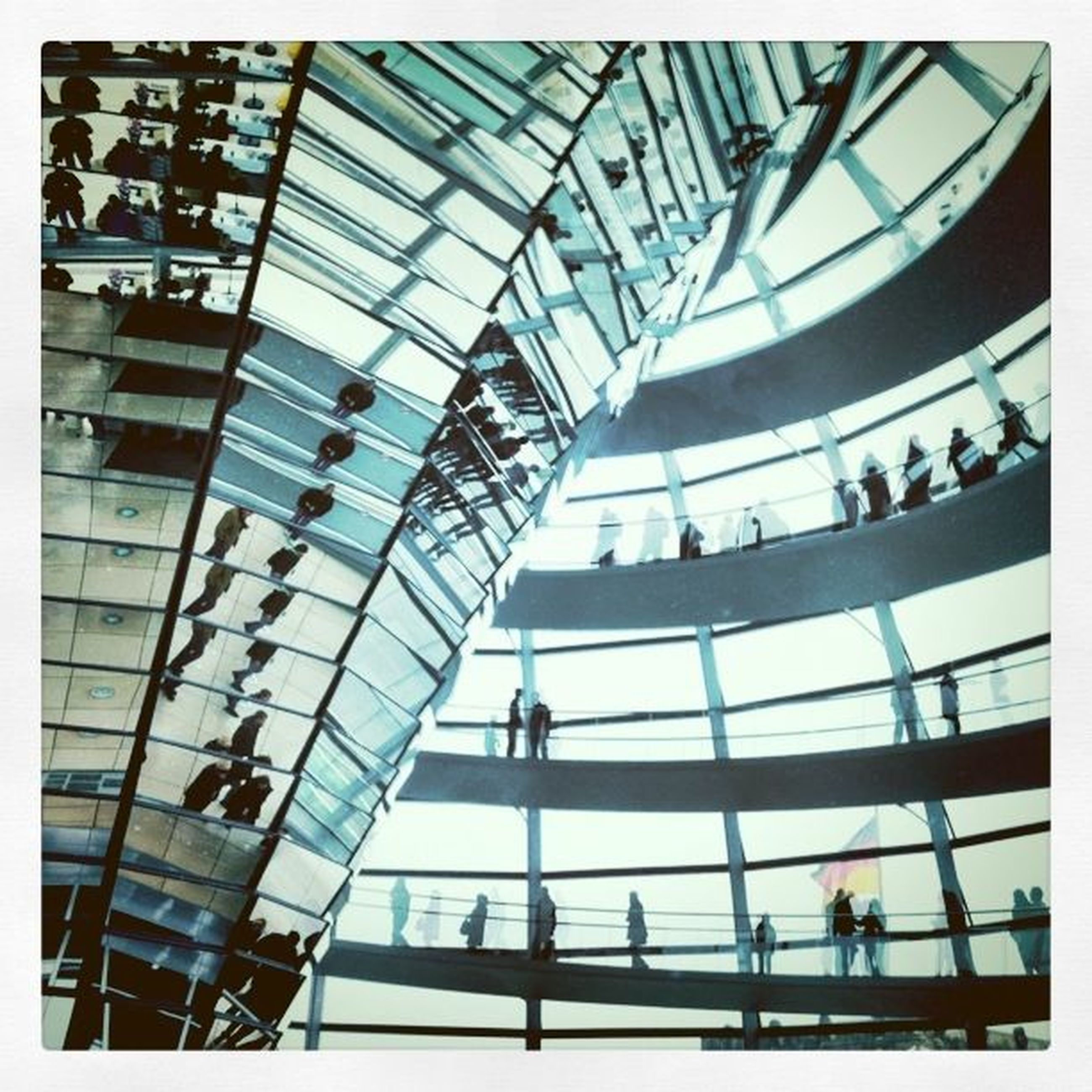 architecture, built structure, transfer print, building exterior, modern, low angle view, glass - material, indoors, auto post production filter, large group of people, city, building, men, office building, city life, famous place, day, ceiling, reflection