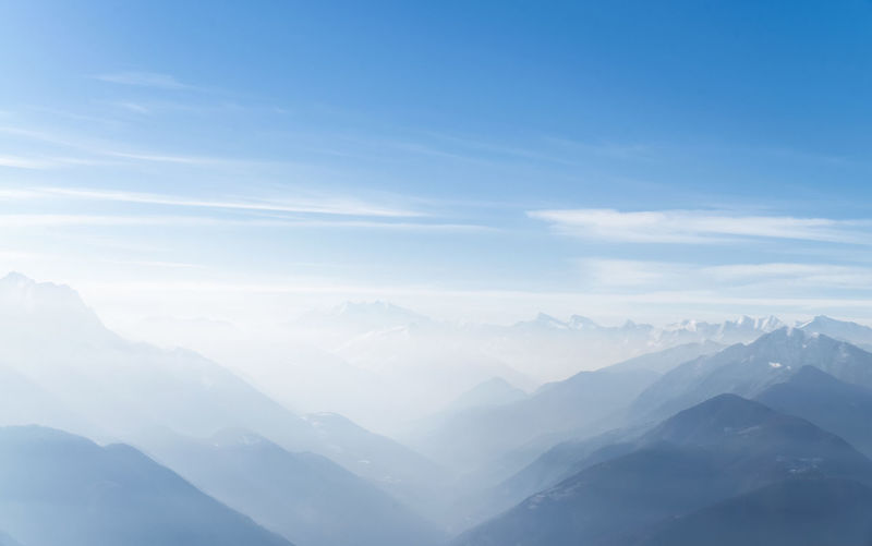 Swiss Alps Peak and Horizon Horizon Over Land Mountain Beauty In Nature Sky Scenics - Nature Tranquil Scene Mountain Range Panorama Idyllic Environment Landscape Fog No People Day Majestic Mountain Peak Outdoors Nature Sunlight Cloud - Sky Clear Sky Tranquility Bright