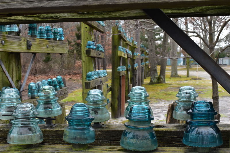 His entire yard is fenced in by his collection of insulators Railroad Track Collection Display Fence Glass Insulators Telegraph Yard Decorations