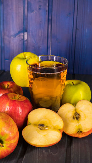 Food And Drink Fruit Food Healthy Eating Freshness Wellbeing Apple - Fruit Wood - Material Household Equipment Indoors  Drinking Glass Table Glass Still Life No People Drink Refreshment Close-up Group Of Objects Container Ripe