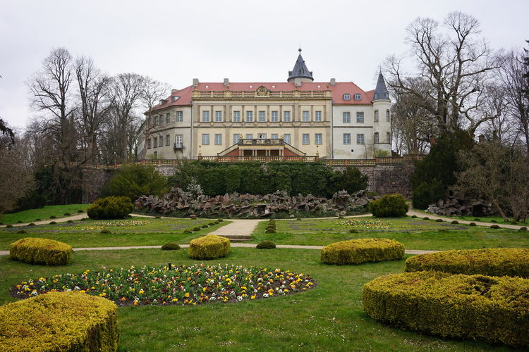View of formal garden with buildings in background