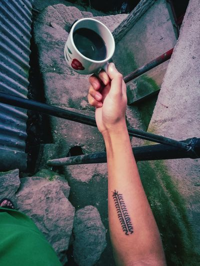 Cropped Hand Holding Coffee Cup