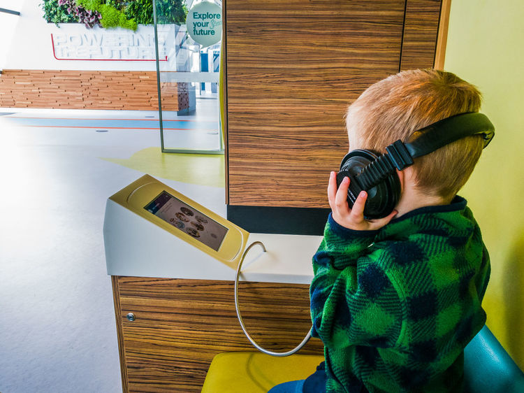 Envision The Future Boy The Portraitist - 2016 EyeEm Awards Headphones Futuristic Office Wood Door Indoors  Day ChildLearning Glasgow Science Centre  Internet Addiction TakeoverMusic