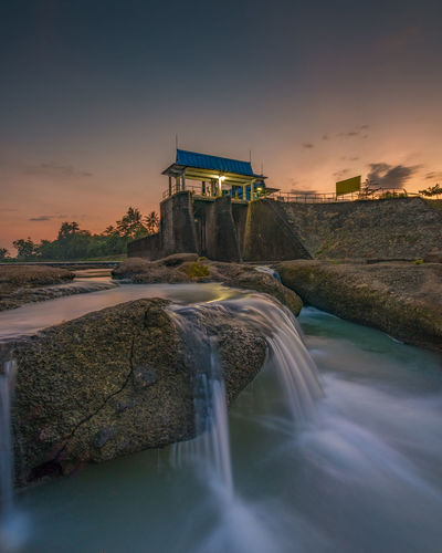 Ohh summer, don't let it dry Water Sunset Sky Built Structure Architecture Scenics - Nature Nature Long Exposure Beauty In Nature Motion Rock - Object Building Exterior Rock Solid Waterfront No People Sea Outdoors Travel Destinations Flowing Water Flowing