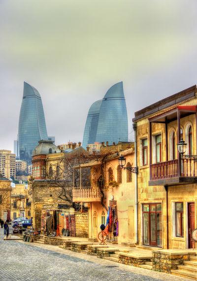 Rear view of people on modern buildings in city