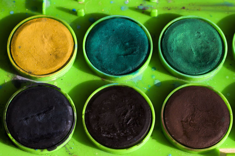 Art And Craft Equipment Backgrounds Black Color Choice Circle Close-up Draw Drawings Geometric Shape Green Color Group Of Objects In A Row Multi Colored No People Paint Variation Water Color Painting