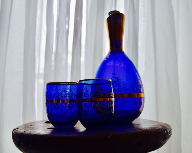 Close-up of blue bottle on table