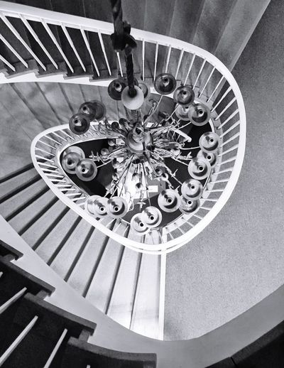 Staircase with a really old candlestick chandelier - Chandelier Steps And Staircases Railing Spiral Staircase Steps Spiral Staircase Spiral Stairs Architecture Built Structure Stairs No People Indoors  Clock Vertical Day
