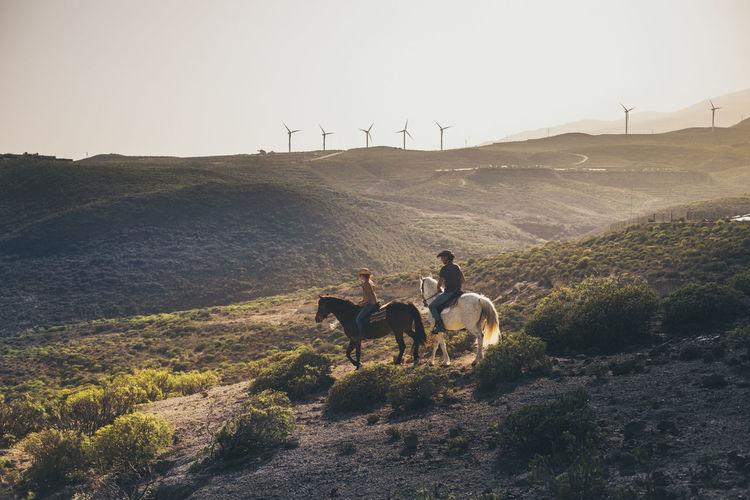 Friends horseback riding on mountain