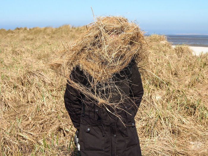 perfect camouflage Joke Real People Standing Adult Unrecognizable Person Outdoors Obscured Face Sunlight Grass Land