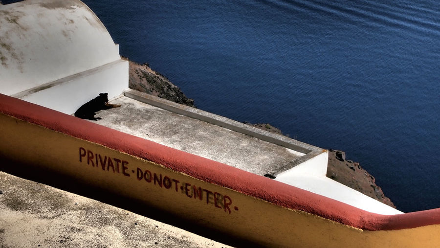 High angle view of text on boat against sea
