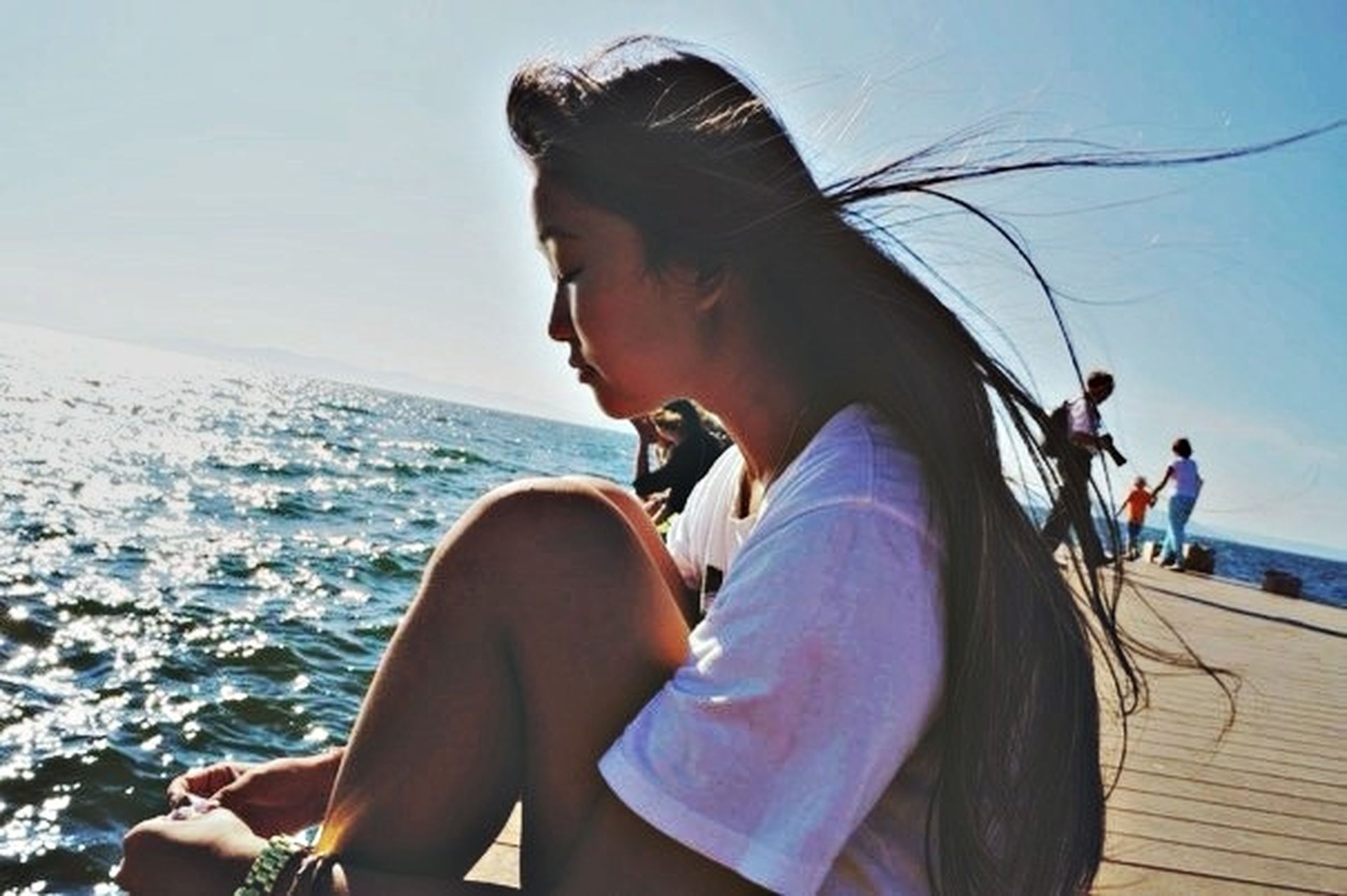 sea, lifestyles, leisure activity, young adult, water, vacations, young women, beach, tourism, tourist, sitting, person, sky, travel, casual clothing, relaxation, day
