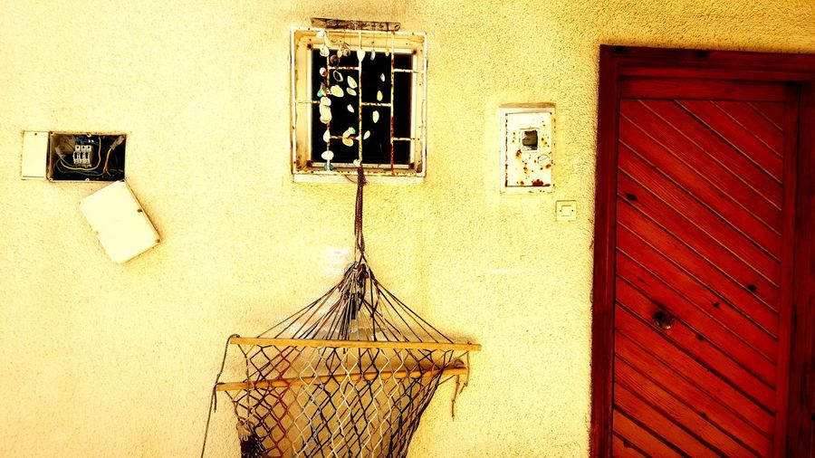 Door Olddoor Window Hammock Oldwall Wall Shells Taking Photos EyeEm Best Shots Wallpanel Electricpanel Yellow EyeEmNewHere