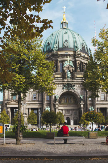 Berlin Building Exterior Architecture Built Structure Tree Dome Building Religion Place Of Worship Plant Belief Spirituality Real People Day Nature Sky Incidental People City One Person Outdoors Cathedral