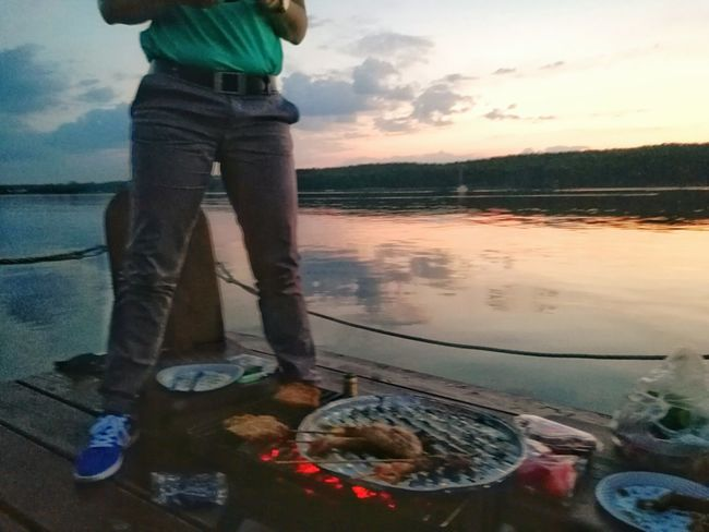 BBQ With Friends on Havel River By Potsdam . Low Section Water Men Standing Lifestyles Person Leisure Activity Casual Clothing Togetherness Cloud - Sky Shore Sky Outdoors Vacations Remote Potsdam_city Havelland Germany Tranquil Scene Food And Drink Industry