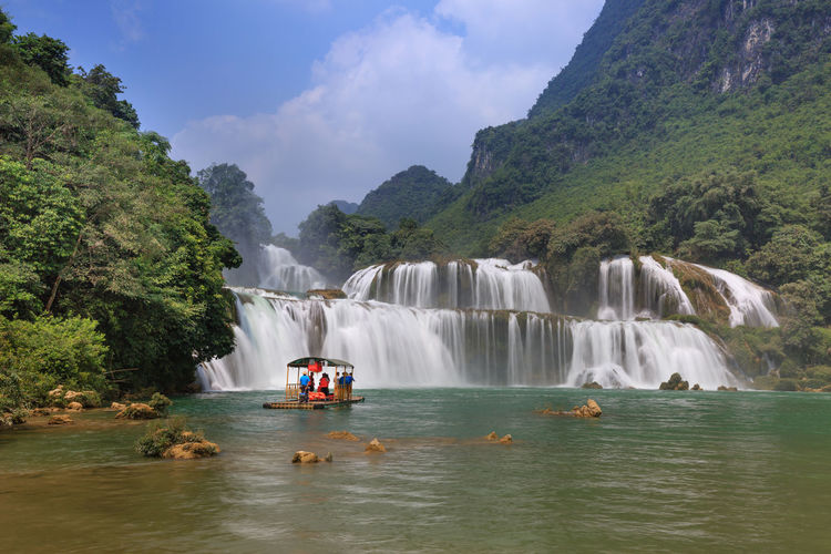 Scenic view of waterfall in river
