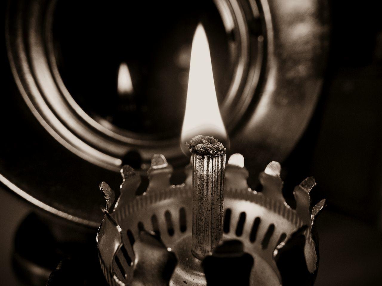Close-Up Of Oil Lamp In Darkroom