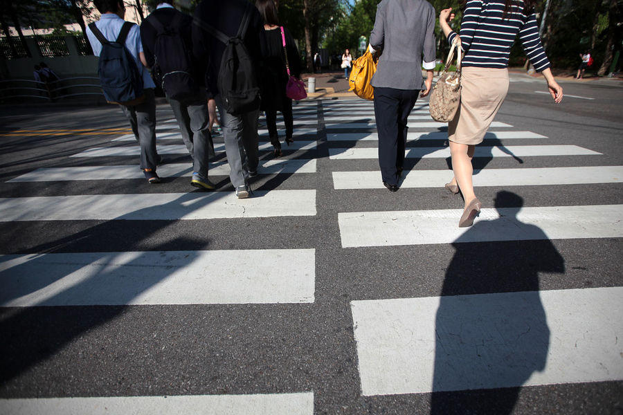 Group of people crossing street Group Of People City Low Section Street Walking Real People Road Men Shadow Day Crosswalk Sunlight Road Marking Crossing Adult Lifestyles Nature Women Zebra Crossing Body Part Outdoors Human Limb Busy