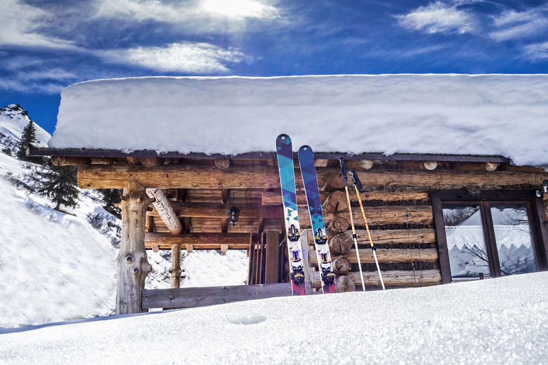 Snow covered hut with skis at the mountains Alps Bavaria Bayern Chalet Freeskiing Holiday Hut Ischgl Montafon Mountain Mountaineering Nature No People Nobody Outdoors Powder Powder Snow Ski Ski Mountaineering Skiing Snow Soelden Sun Südtirol Winter