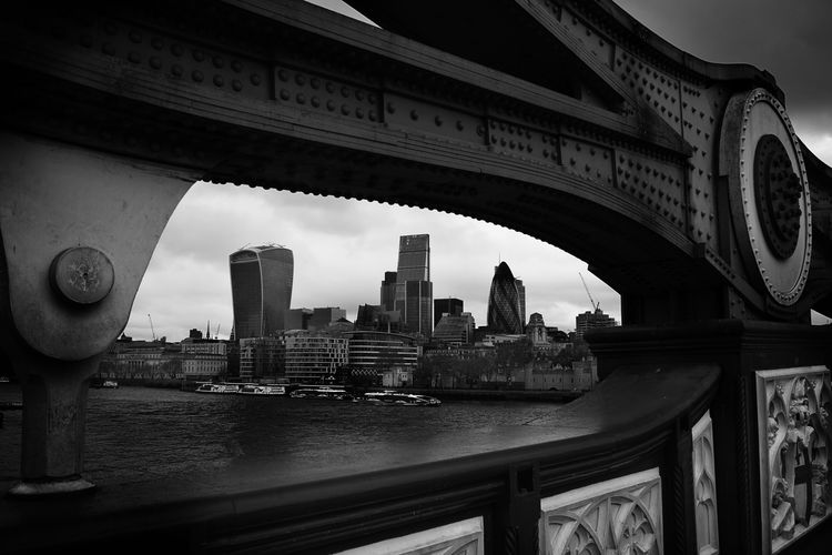 30 st mary axe and thames river seen through tower bridge in city