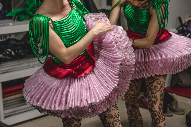 Midsection of dancers in costumes