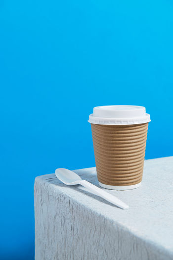 Close-up of coffee on table against blue background