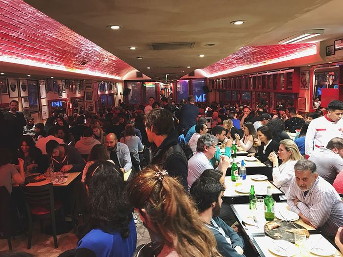 Pizzeria Guerrin People Pizzeria Guerrin, La Mejor Pizza De Buenos Aires Guerrin Group Of People Crowd Real People Large Group Of People Women Illuminated Food And Drink Architecture Business Indoors  Lifestyles Restaurant Leisure Activity Adult Lighting Equipment Shopping Ceiling Cafe Table