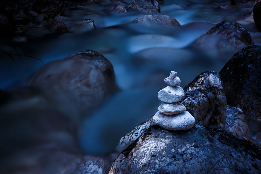 Blueished Cairn / Stoamandl at Aschauer Klamm, Schneizlreuth, Bavaria, Germany Beauty In Nature Cold Temperature Day Flowing Flowing Water Hiking Long Exposure Longexposure Mountain Nature No People Outdoors Representing River Rock Rock - Object Rocks Scenics Sculpture Statue Still Life Wanderlust Water Winter Wonderful