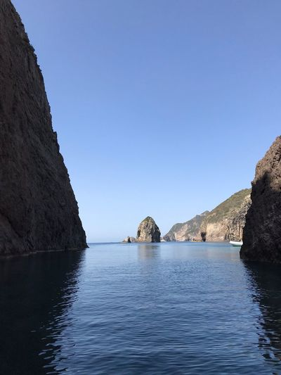 Exit of Grotta dì mezzogiorno Palmarola Italy Water Sky Sea Clear Sky Waterfront Beauty In Nature Blue Rock Outdoors Tranquility Tranquil Scene Copy Space Scenics - Nature Nature Rock - Object Day Solid No People Rock Formation Mountain