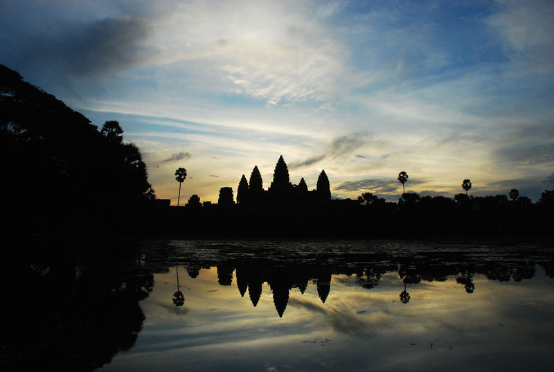 Angkor Wat Angkor Wat Siem Reap Kmer Culture Angkor Wat, Cambodia, Royal Ballet Of Cambodia, Monument, Siem Reap Angkor Wat, Temples, Kmer Culture Architecture Built Structure Cloud - Sky Cultures Dawn Day Kingdom Of Cambodia Lake Nature No People Outdoors Place Of Worship Reflection Siem Reap Silhouette Sky Tranquility Travel Destinations Tree Water