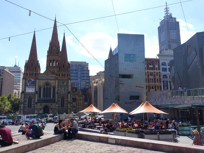 View from Federation Square, Melbourne Built Structure Architecture Building Exterior City Building Sky Group Of People Nature Crowd Real People Tower Day Large Group Of People City Life Travel Destinations Men Women Lifestyles Adult Outdoors Office Building Exterior Skyscraper Cityscape Federation Square St Paul's Cathedral