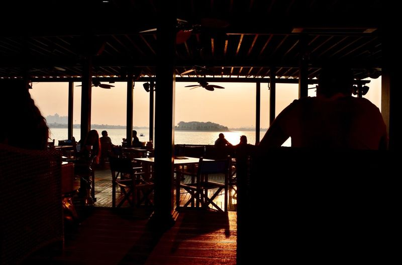 Rear View Silhouette Sea Real People Sunset Nature People Anantara Beach Club Beauty In Nature Adult Togetherness Sitting Women Leisure Activity Outdoors Luxury Adapted To The City Happiness EyeEmNewHere Waterfront The Street Photographer - 2018 EyeEm Awards