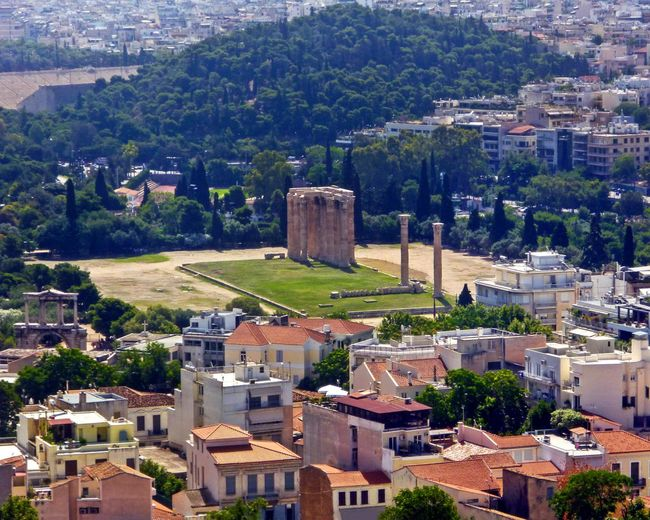 The Temple of Olympian Zeus in Athens, Greece Greek History Athina Columns And Stone Ancient Greece Ancient Greek Architecture And Design Buildings View Of Athens Athens Athens, Greece Athens City Athens Greece Athensvibe Athens View Temple Of Olympian Zeus Hadrians Arch Cityscape City Mountain Residential Building Community Architecture Building Exterior Built Structure Housing Settlement Human Settlement Tiled Roof  Rooftop Settlement Residential  Roof My Best Photo