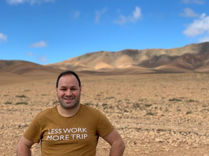 Fuerteventura Canary Islands Desert One Person Environment Looking At Camera Land Portrait Landscape Real People Scenics - Nature Front View Nature Sky Beauty In Nature Men Non-urban Scene Arid Climate Climate Mid Adult Men Day Lifestyles