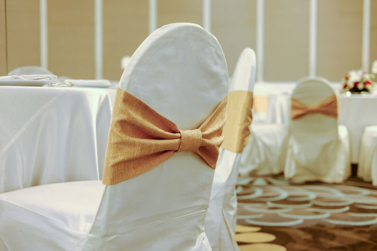Close-up of chairs by table during wedding ceremony