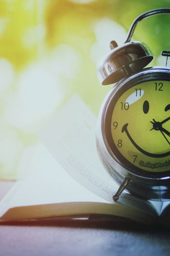 Alarm Clock Time Clock Instrument Of Time Clock Face Bell Smiley Smiley Face Smileyclock Bokeh Clockwithbook Book Smileyworld Minute Hand Hour Hand No People Close-up Indoors  Day