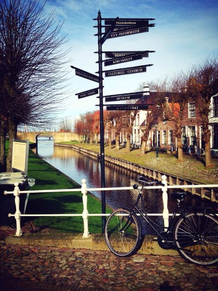 Transportation Built Structure Sky Tree Land Vehicle Outdoors Water Mode Of Transport No People Architecture Nature Streetphotography Dutch Landscape Travel Destinations Bike Dutch House Winter 2017 Neighborhood Map Stories From The City