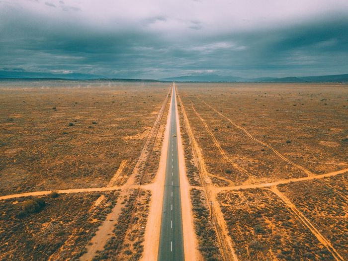 straight roads & storms. Mavic Pro Drone  EyeEm Selects Sky Cloud - Sky Environment Landscape Land Diminishing Perspective Nature vanishing point The Way Forward Direction No People Horizon Outdoors Day Scenics - Nature Road